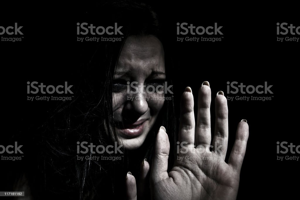Abused Woman Pleading Stop stock photo