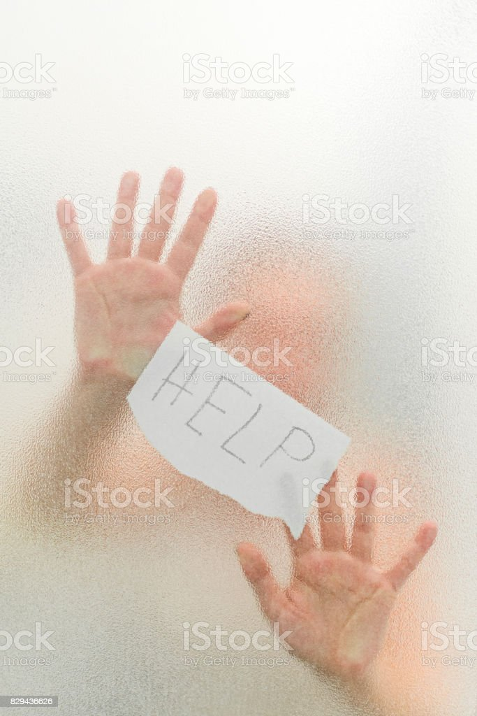 Abused woman seeks help from violence holding a paper stock photo