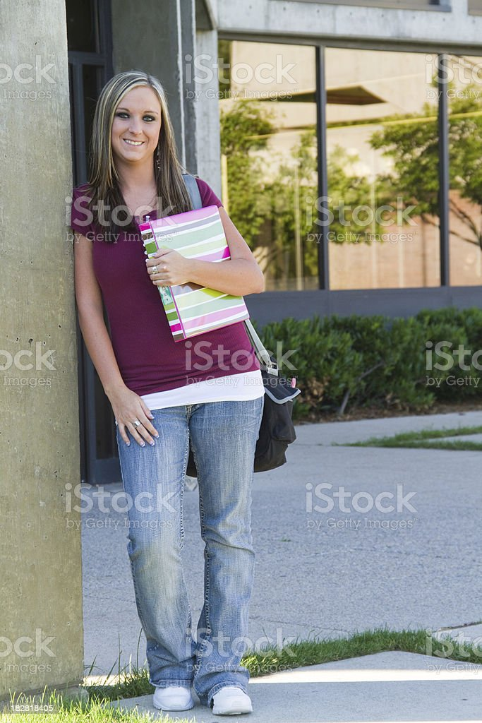 Academic and attractive student pauses before class stock photo