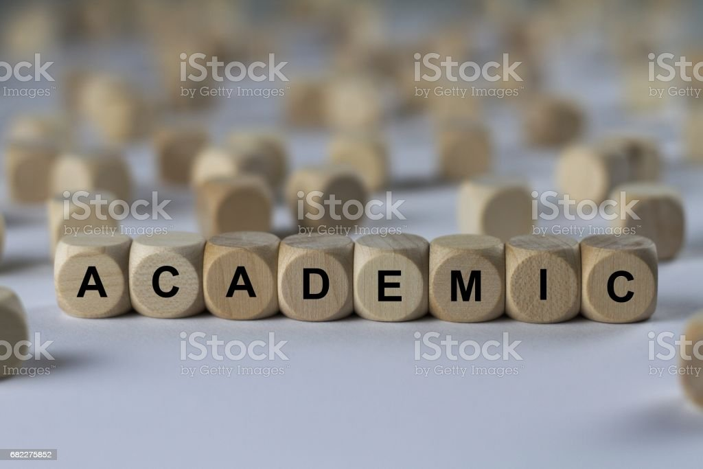 academic - cube with letters, sign with wooden cubes stock photo