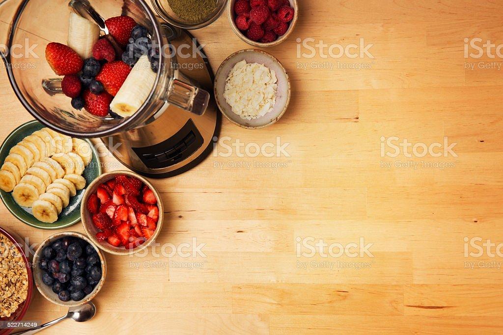 Acai Fruit Smoothie Bowl Ingedients with Blender and Fresh Fruit stock photo