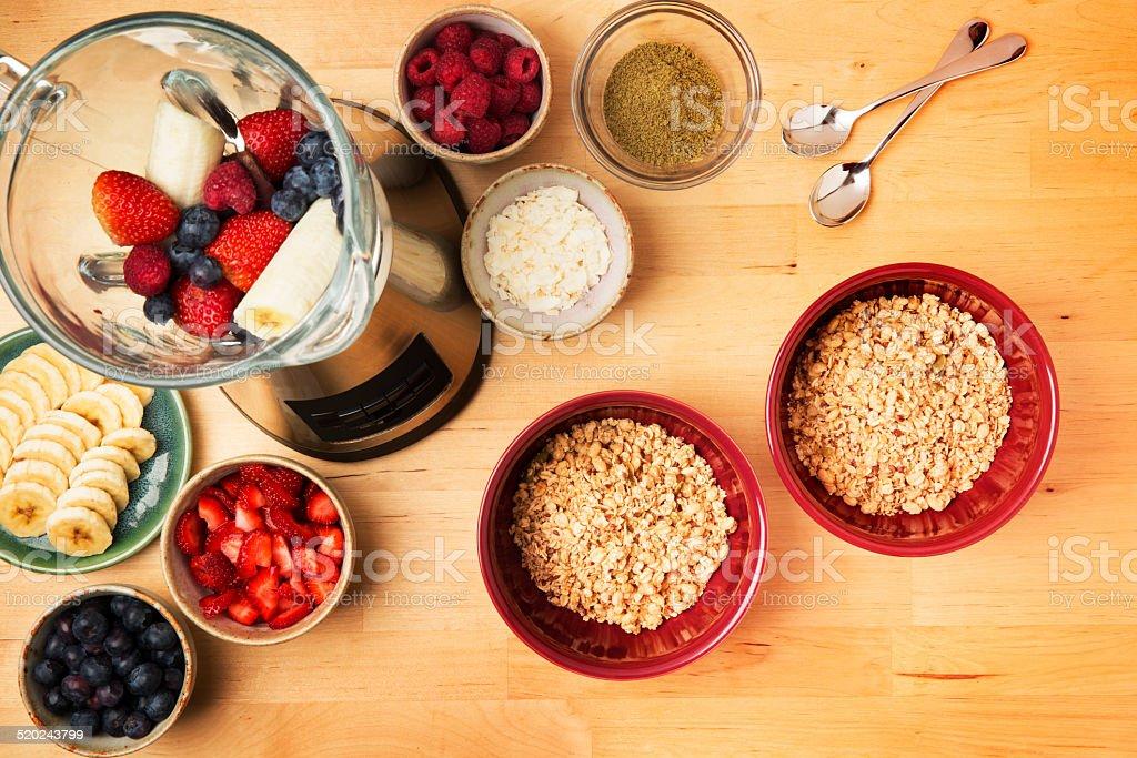 Acai Fruit Smoothie Bowl Surrounded by Fresh Fruit stock photo