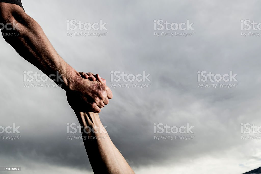 Accepting a helping hand up stock photo