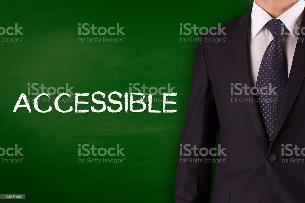 Accessible on blackboard with businessman stock photo