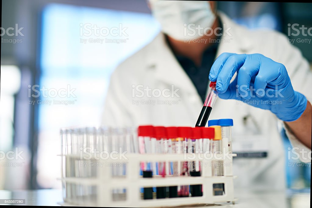 Accessing the general state of his patient's health stock photo