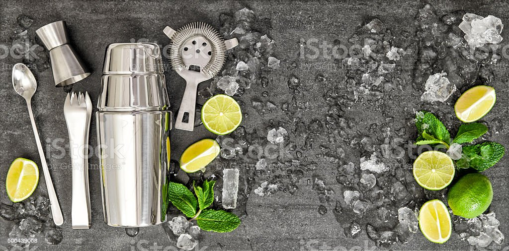 Accessories and ingredients for cocktail lime, mint, ice stock photo