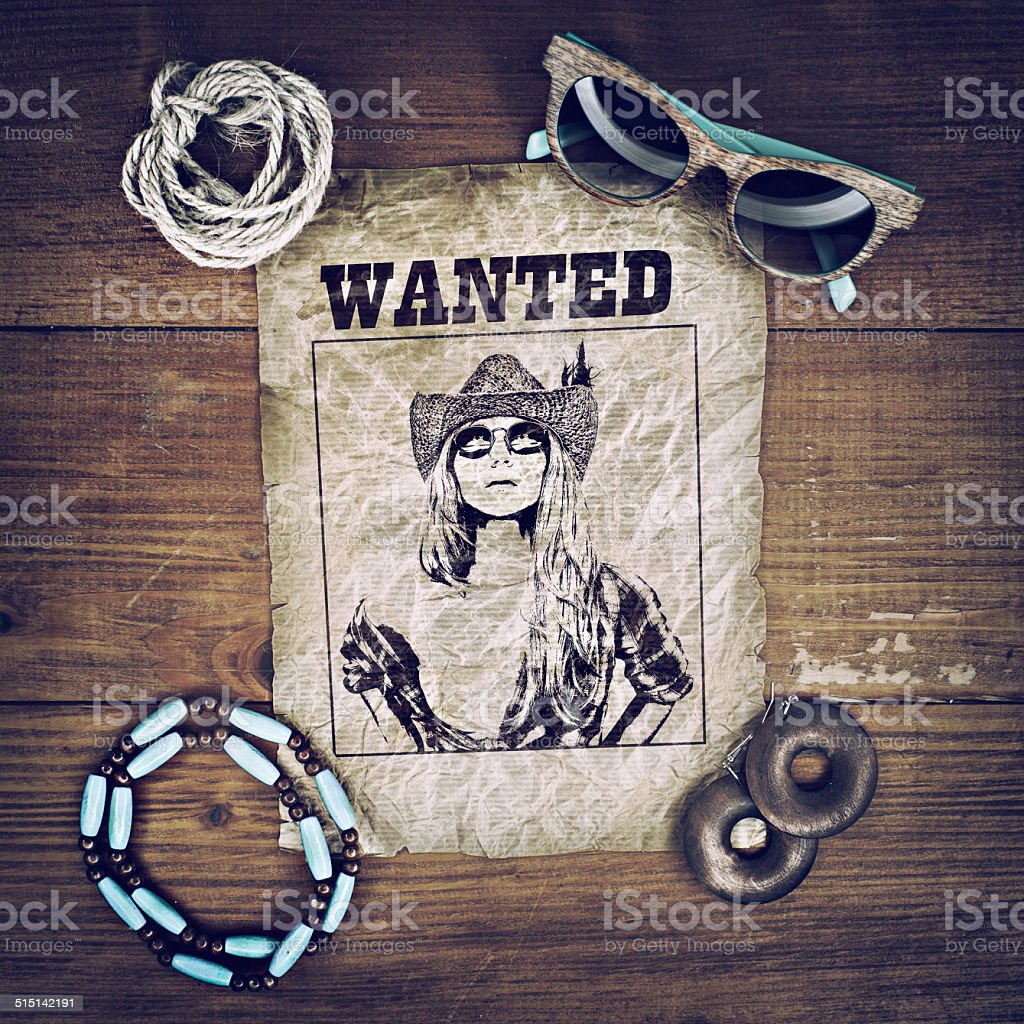 Accessories cowboy retro style on wooden background with wanted poster stock photo