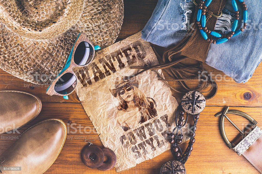 Accessories cowboy retro style on wooden surface with wanted pos stock photo