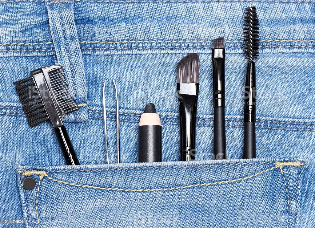 Accessories for care of the eyebrows in jeans pocket stock photo