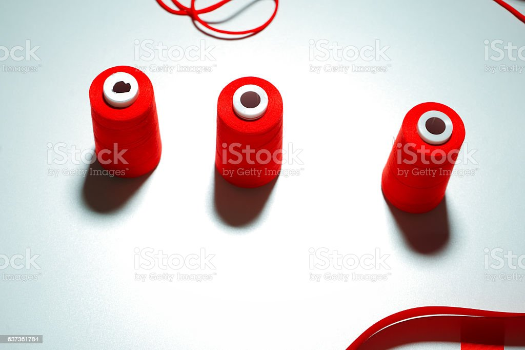 Accessories for sewing lie on a white background. Measuring tape stock photo