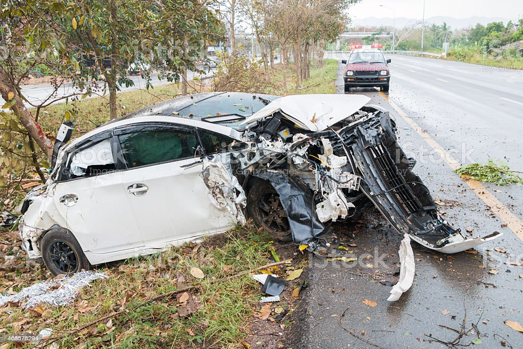 Accident car crash with tree on the road stock photo