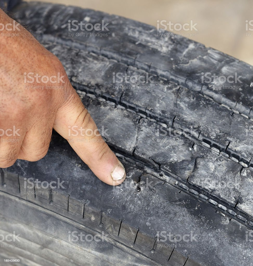 Accident Risk with unsafe tire stock photo