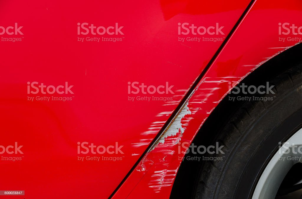 Accident - Smashed body of red car stock photo
