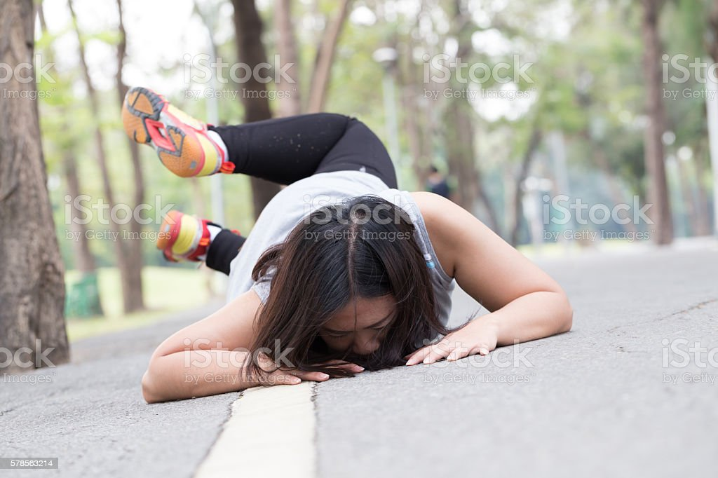 Accident. stumble and fall while jogging stock photo