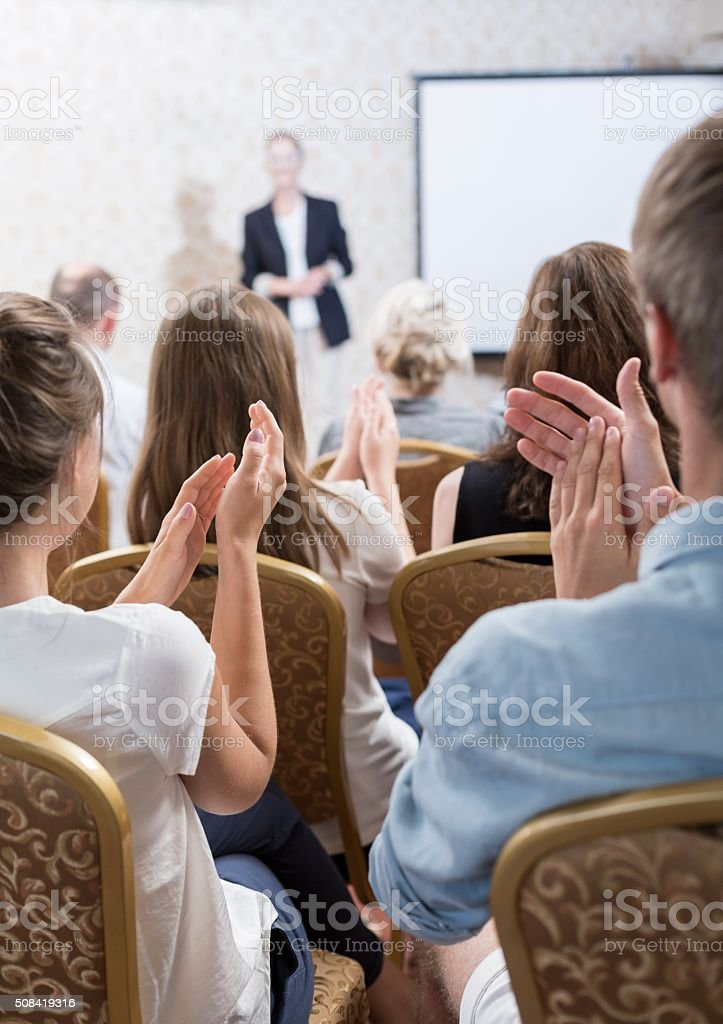 Acclaiming public speaker stock photo