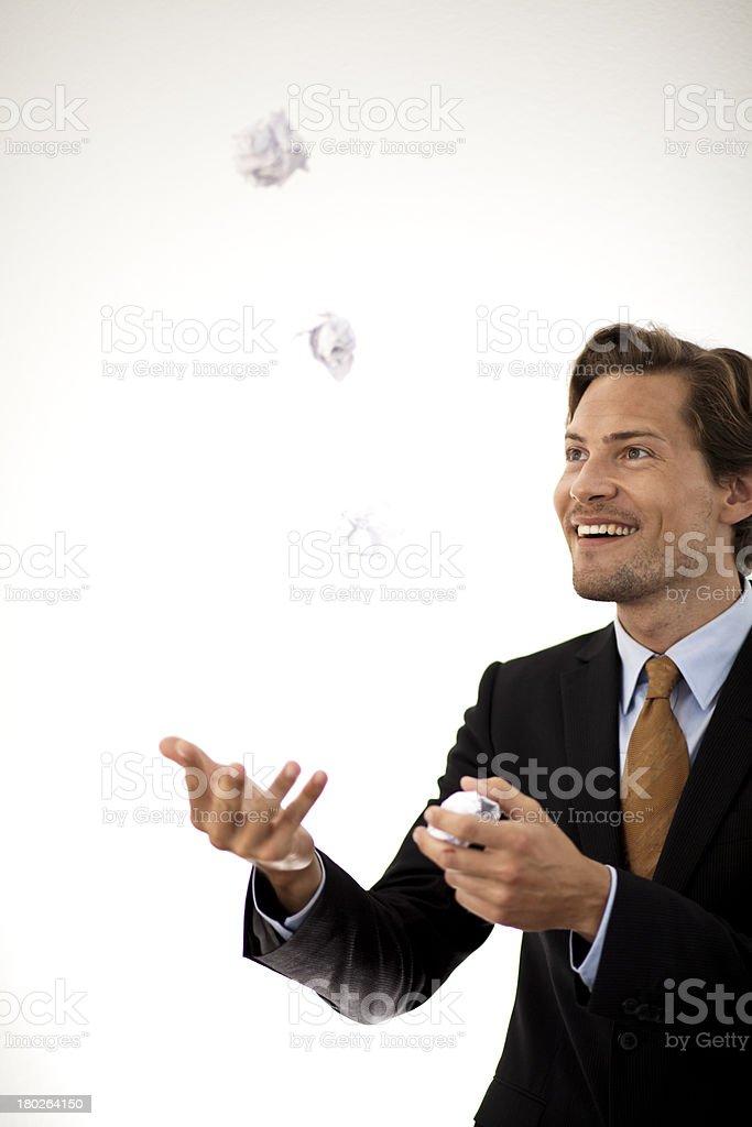 Accomplished businessman juggling paper stock photo