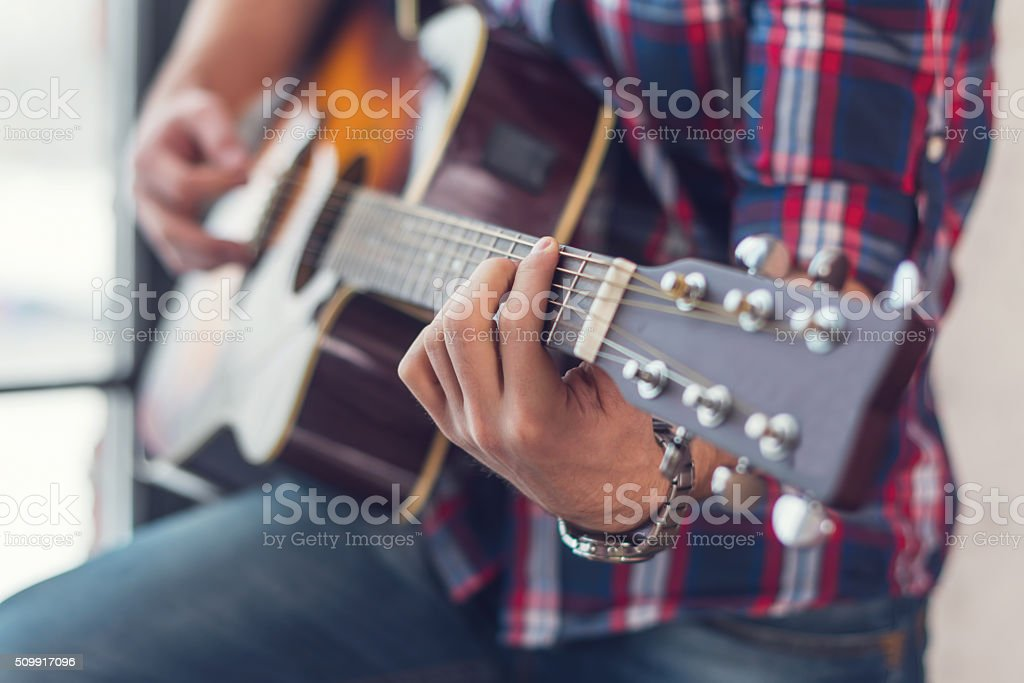 Accord chord, Close up of mens hands playing an acoustic stock photo