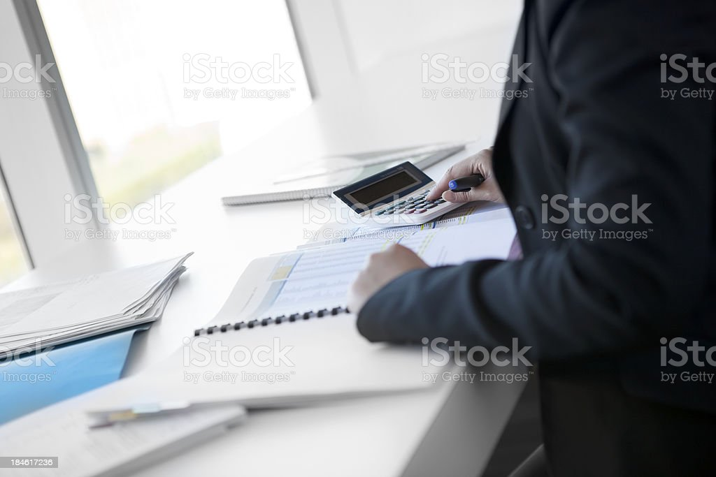 Accountant focussing on her work royalty-free stock photo