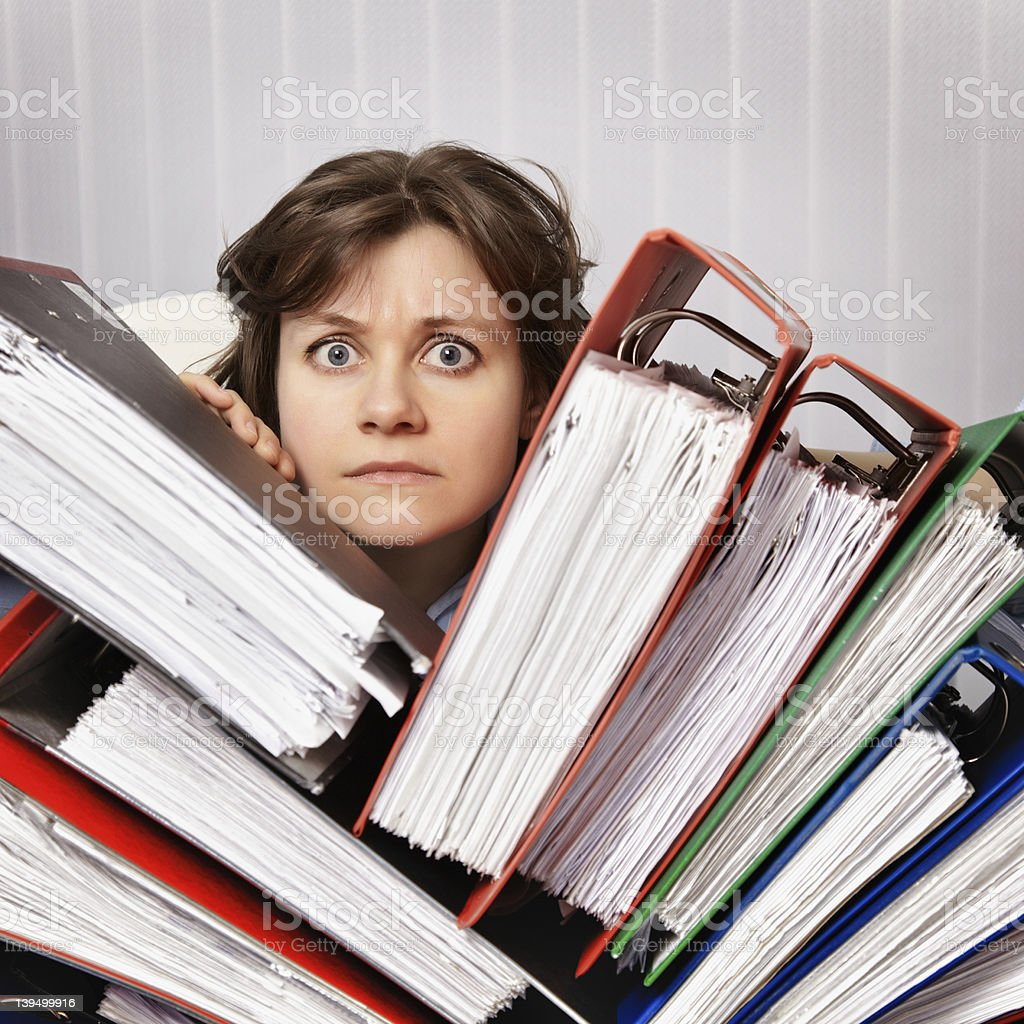 Accountant swamped with financial documents royalty-free stock photo