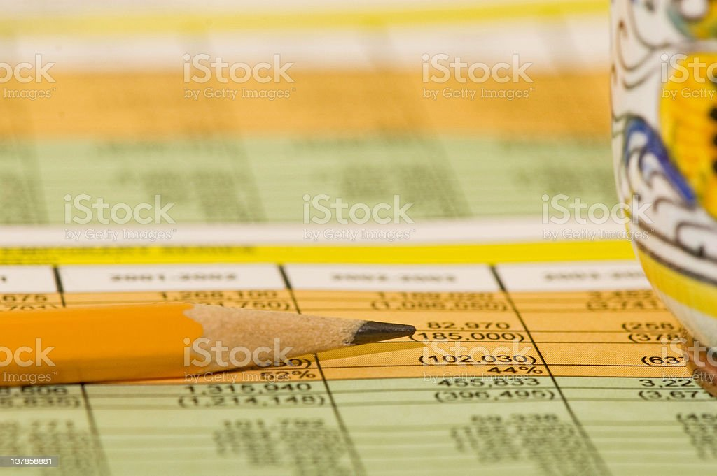 accountant worksheet, pencil and coffee cup close up royalty-free stock photo