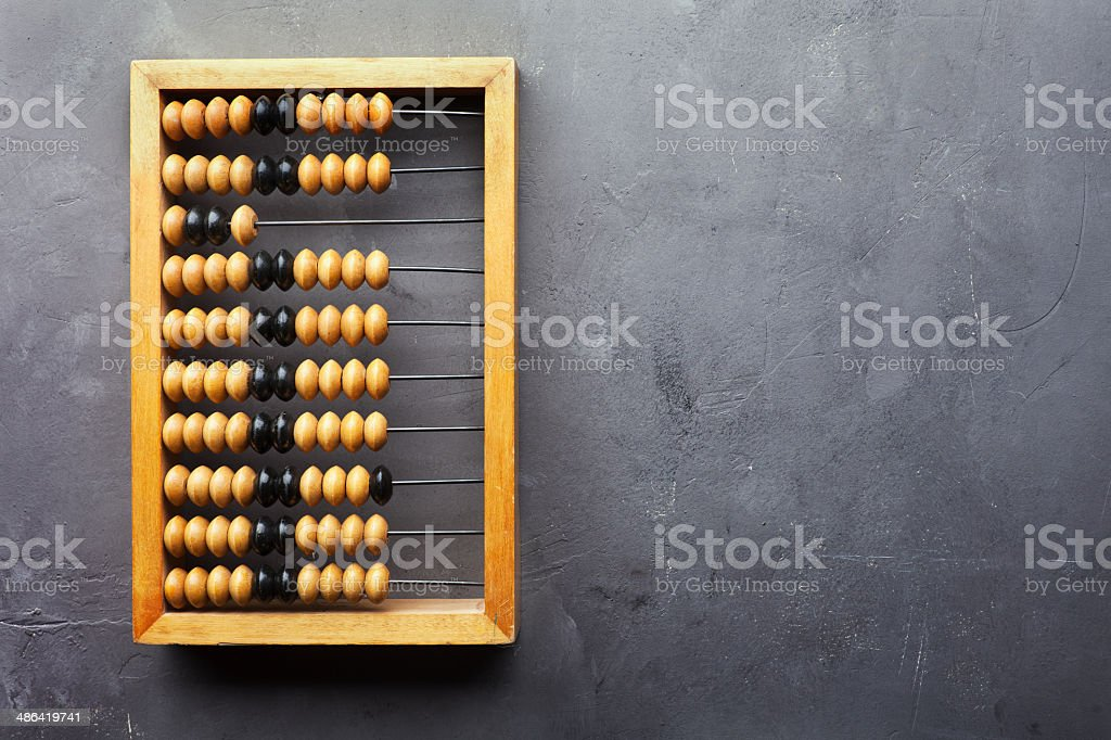 Accounting abacus on gray textured background stock photo