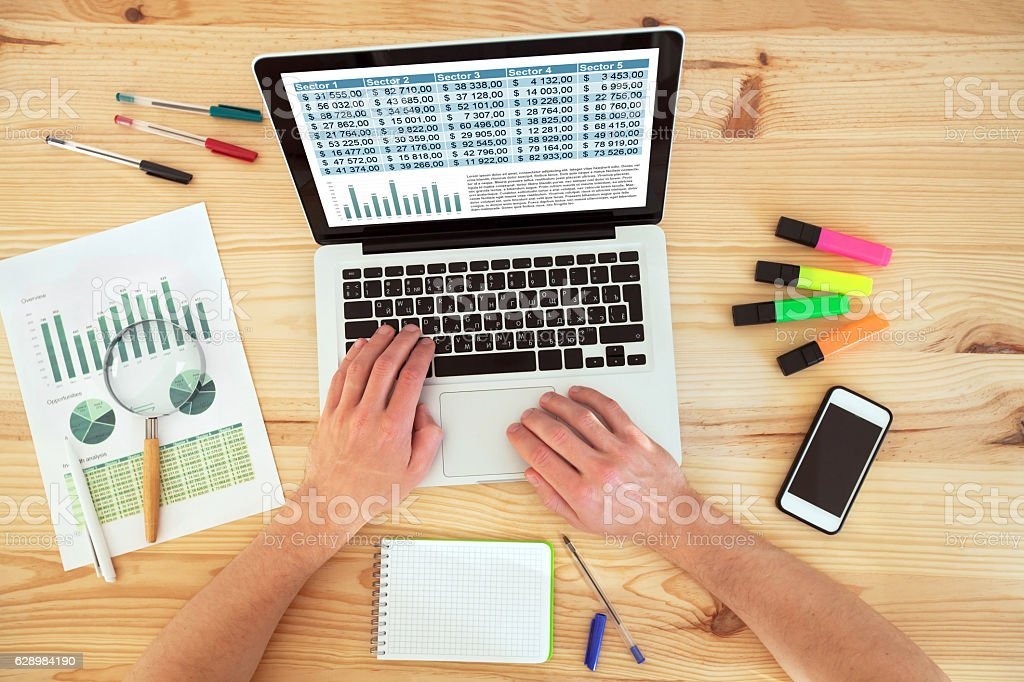 accounting concept, writing in spreadsheet of financial report stock photo