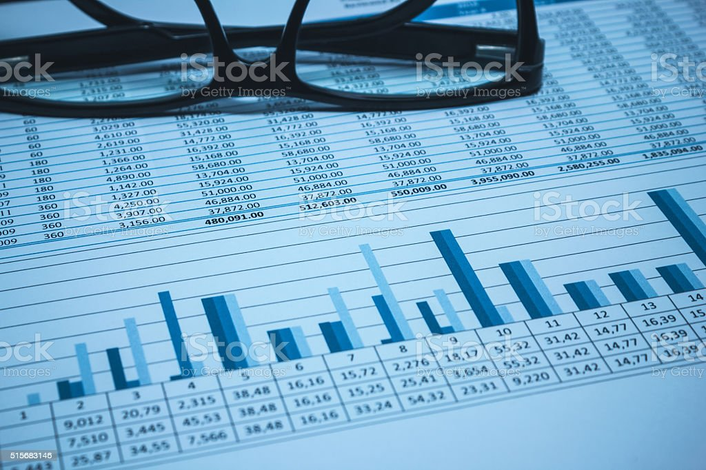 Accounting financial banking account spreadsheet data with glasses in blue stock photo