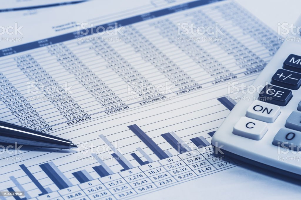 Accounting financial banking banker bank stock spreadsheet data with pen and calculator in blue analysis analyzer calculations stock photo