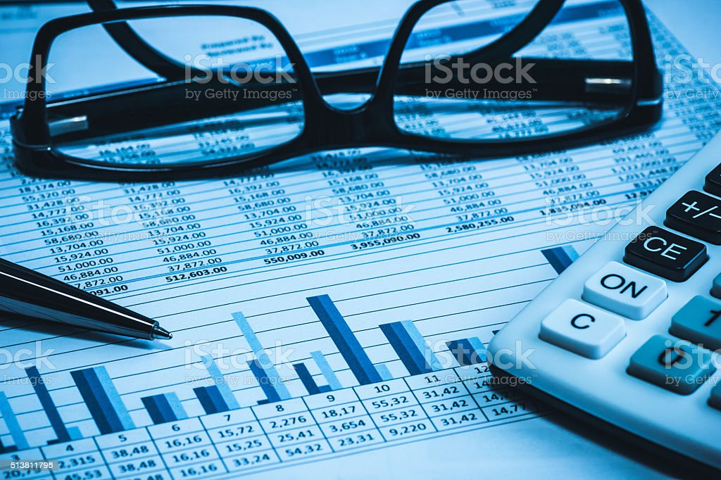 Accounting financial papers analysis with charts stock photo