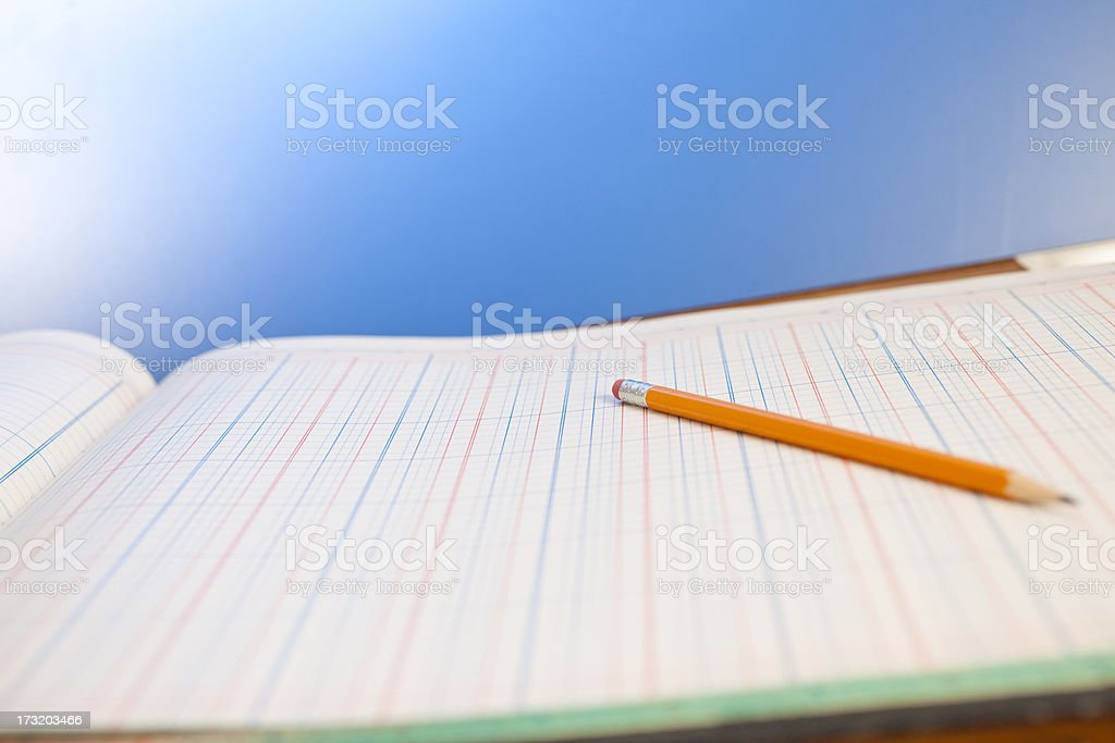 Accounting Ledger page with pencil.  Blue background stock photo