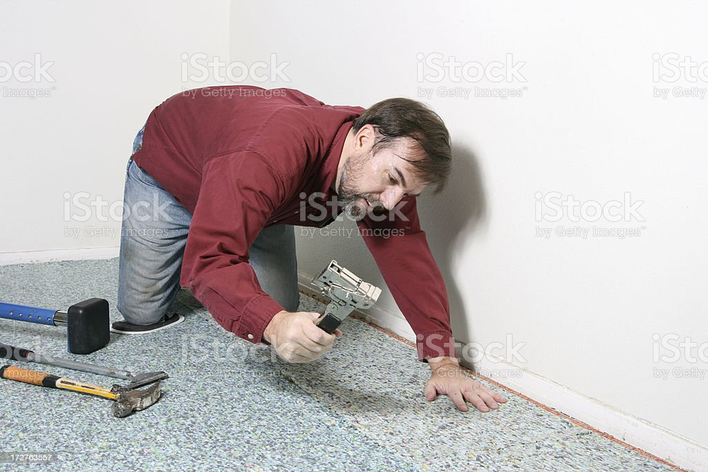 Accurate Carpet Installer royalty-free stock photo