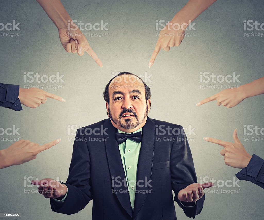accusation of guilty arrogant businessman who shrugs shoulders stock photo