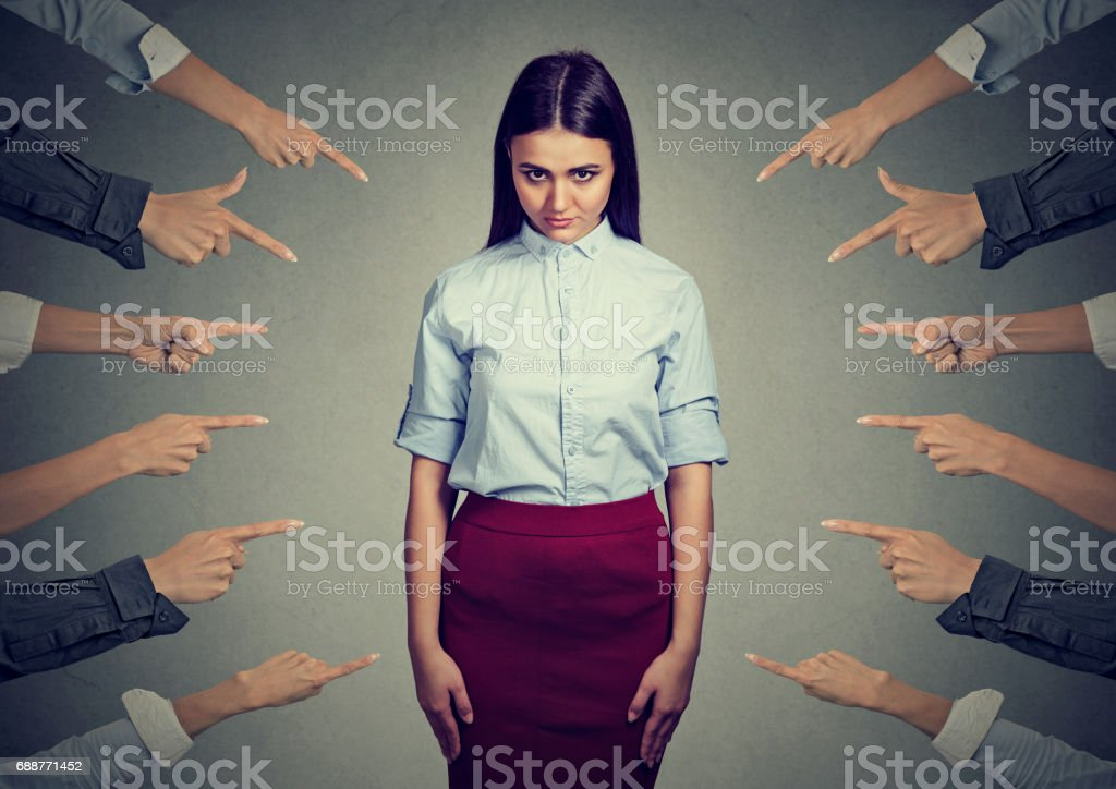 accusation of guilty person. Upset woman, many fingers pointing at her stock photo