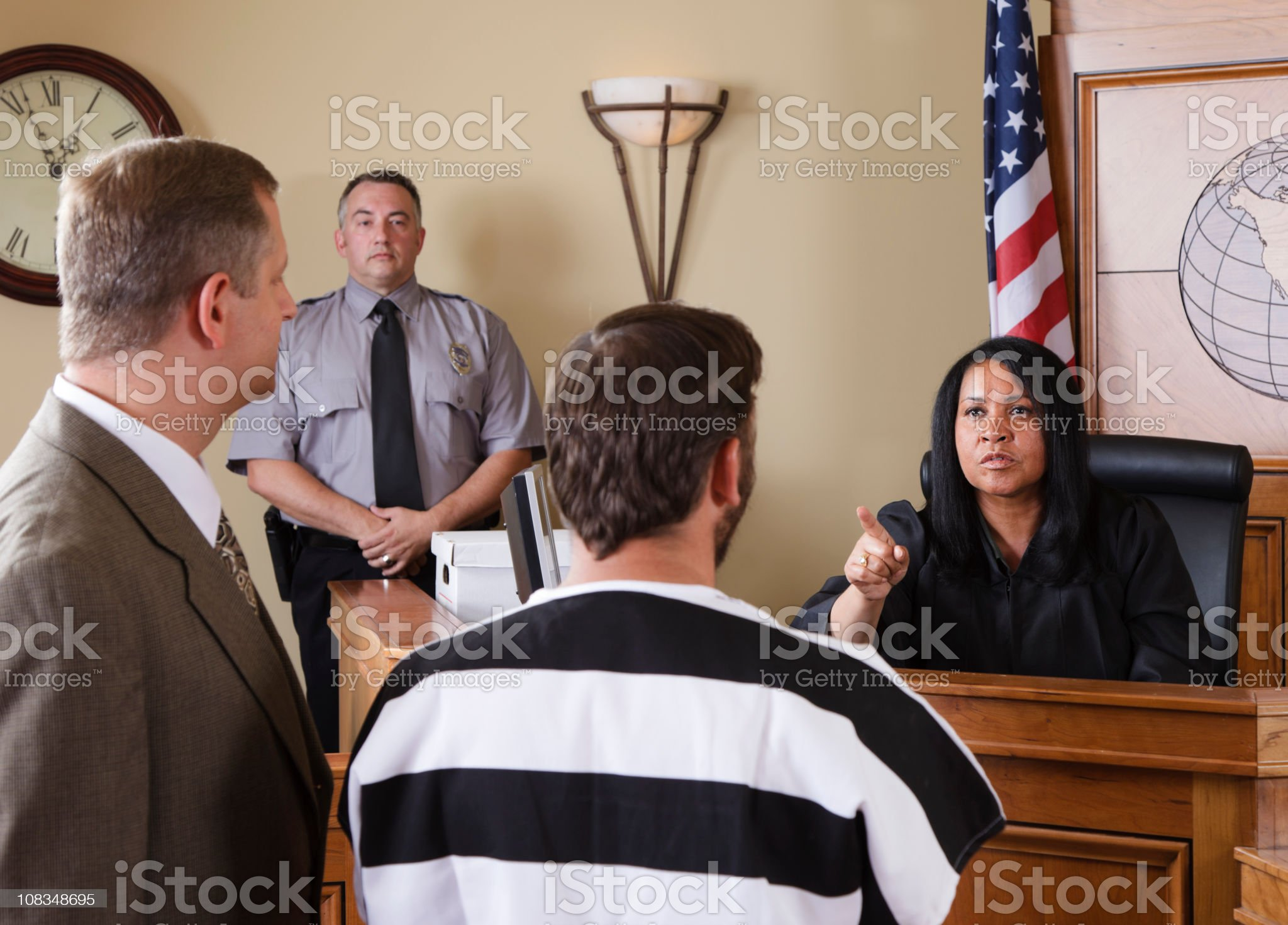 Accused Criminal and Lawyer in a Courtroom royalty-free stock photo