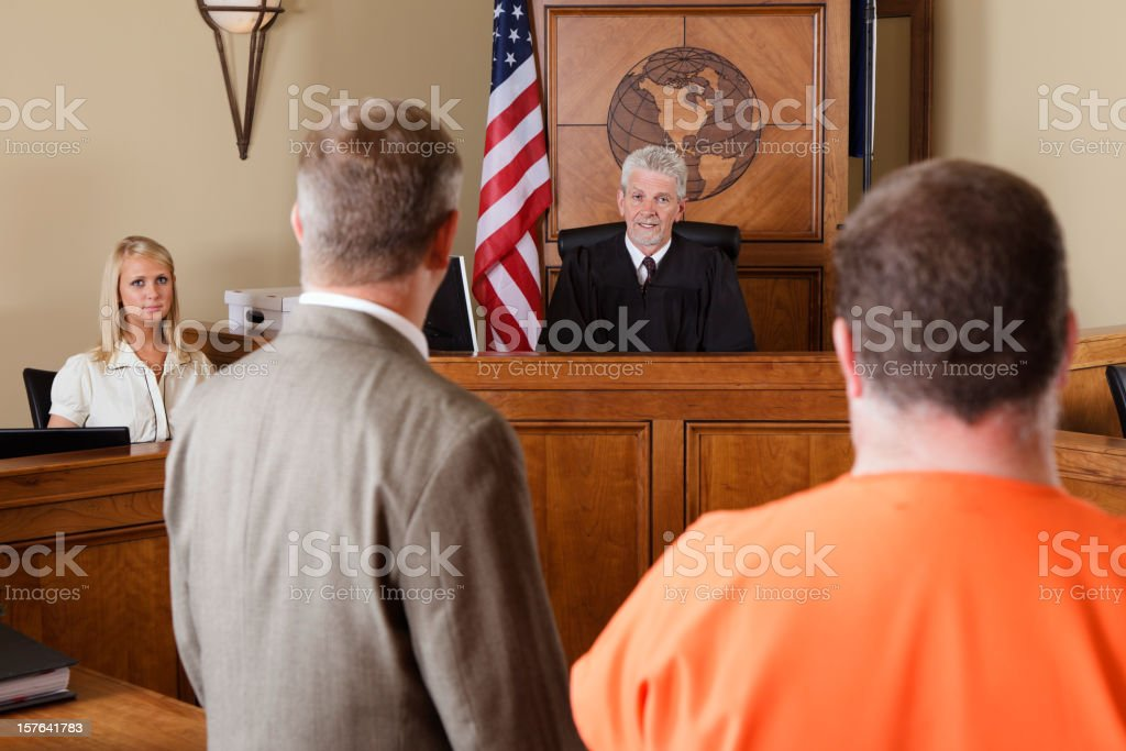 Accused Criminal and Lawyer in a Courtroom stock photo