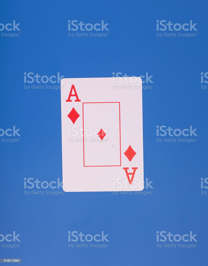 Ace of diamonds playing card,on blue background stock photo
