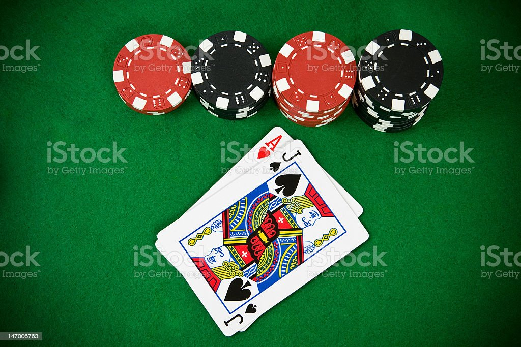 Ace of hearts and black jack with poker chips stock photo