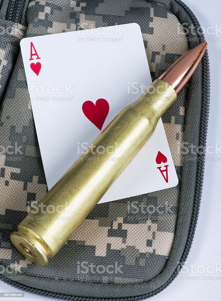 Ace of hearts and bullets. stock photo