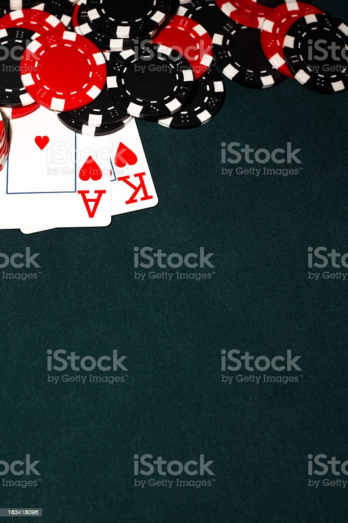 Ace of hearts and King of hearts with pile of poker chips stock photo