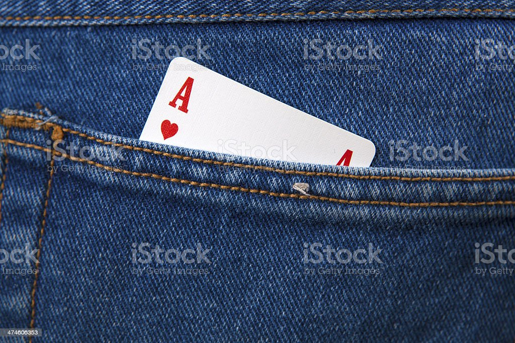 Ace of hearts in  gamblers jeans pocket stock photo
