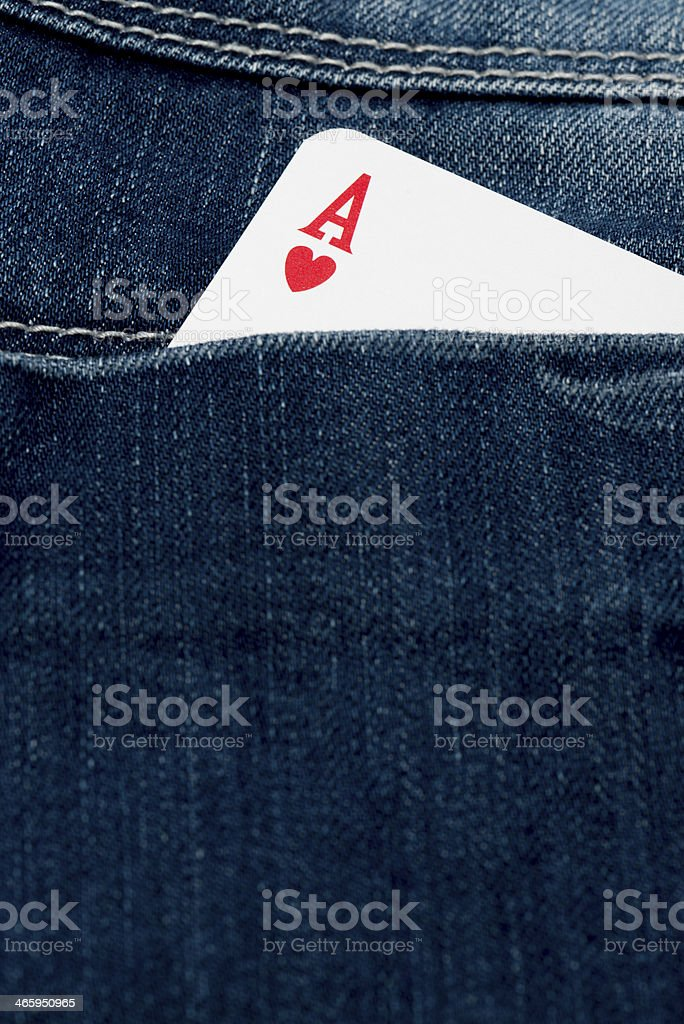 ace of hearts in jeans pocket stock photo