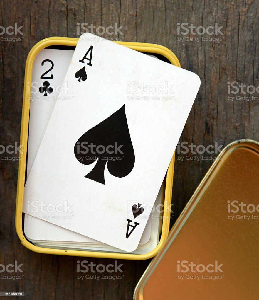 Ace of spades in box on wooden table background stock photo