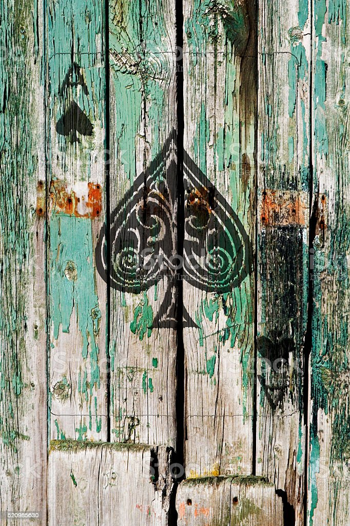 Ace of Spades on old wooden door stock photo