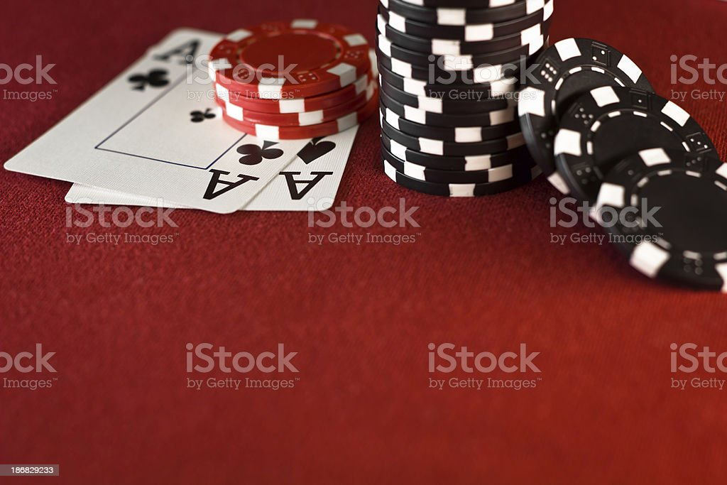 Aces, Casino Chips, Red Poker Table royalty-free stock photo
