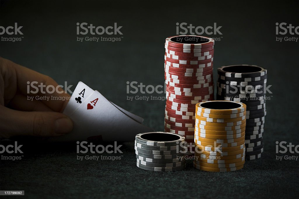 Aces in hand and gambling chips royalty-free stock photo