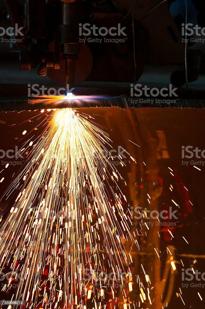 Acetylene torch to cut through metal with sparks close up stock photo