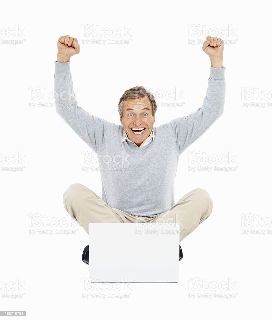 Achievement - Old man with hands raised using laptop royalty-free stock photo