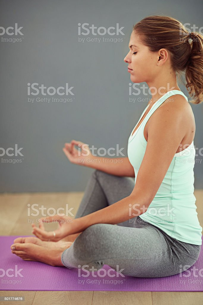 Achieving health and happiness through yoga stock photo