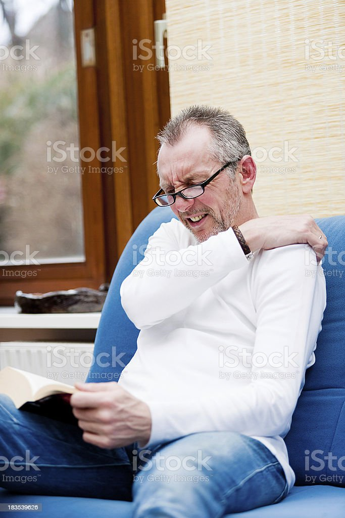 Aching shoulder stock photo