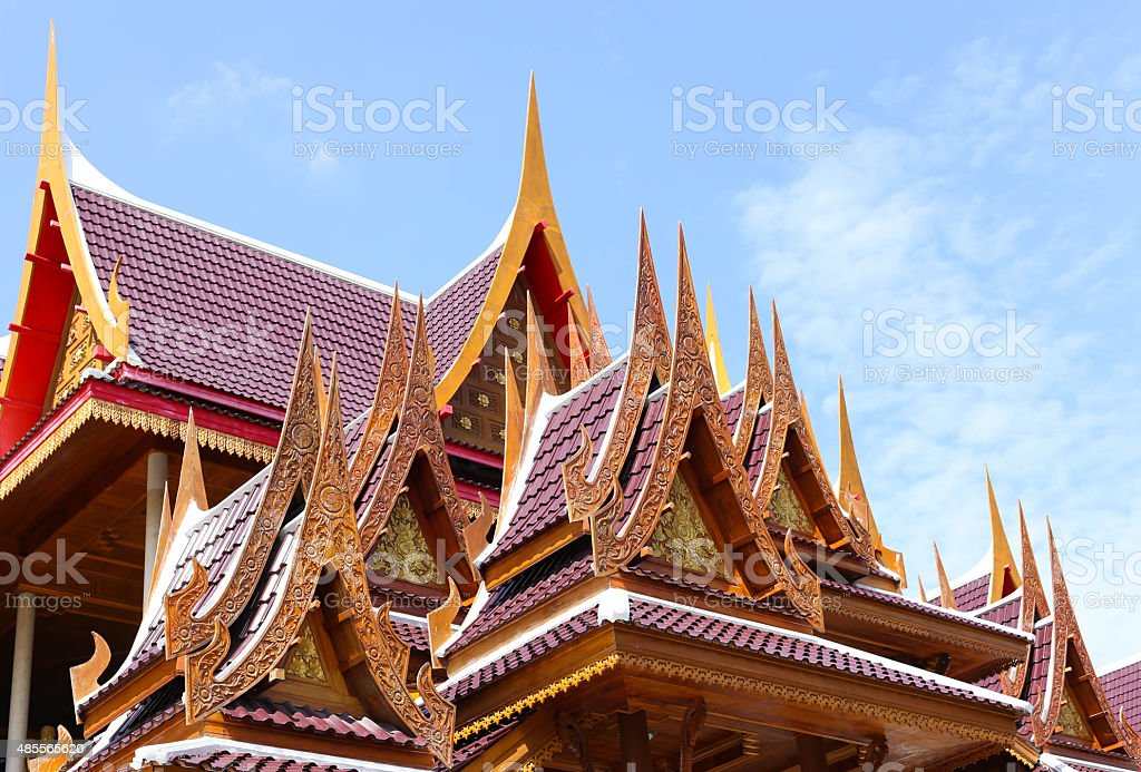 Achitecture building of ancient wooden roof temple in Thailand stock photo